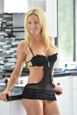 Super fit blonde mom Sydney shows off her six pack before fucking her toys