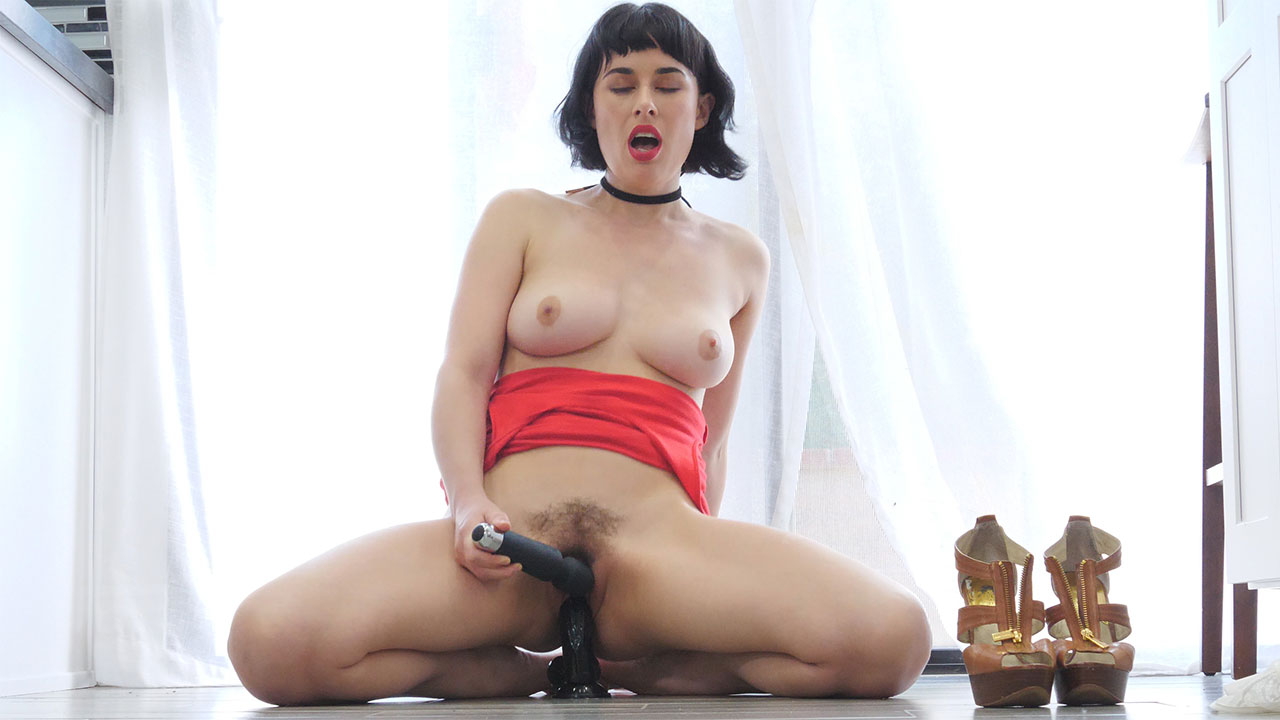Gorgeous mature pinup Olive sits on a toy and buzzes her clit with another