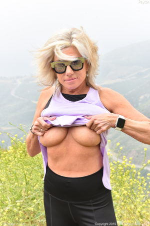 Thick blonde MILF Payton pulls down her yoga pants on the trail to spread her big ass cheeks
