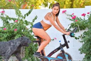 Fun loving fit brunette Sommer works out fucking her yoga ball dildo outside