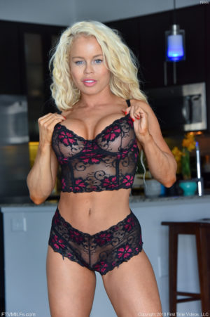 Busty big butt blonde MILF Nikki works out and strips out of her lingerie
