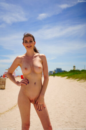 Sexy thin happy MILF Angelina peels of her bikini at the beach to show off her bod
