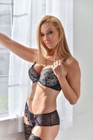 Beautiful blonde FTV MILF Sandy teases in her stockings and panties before removing them